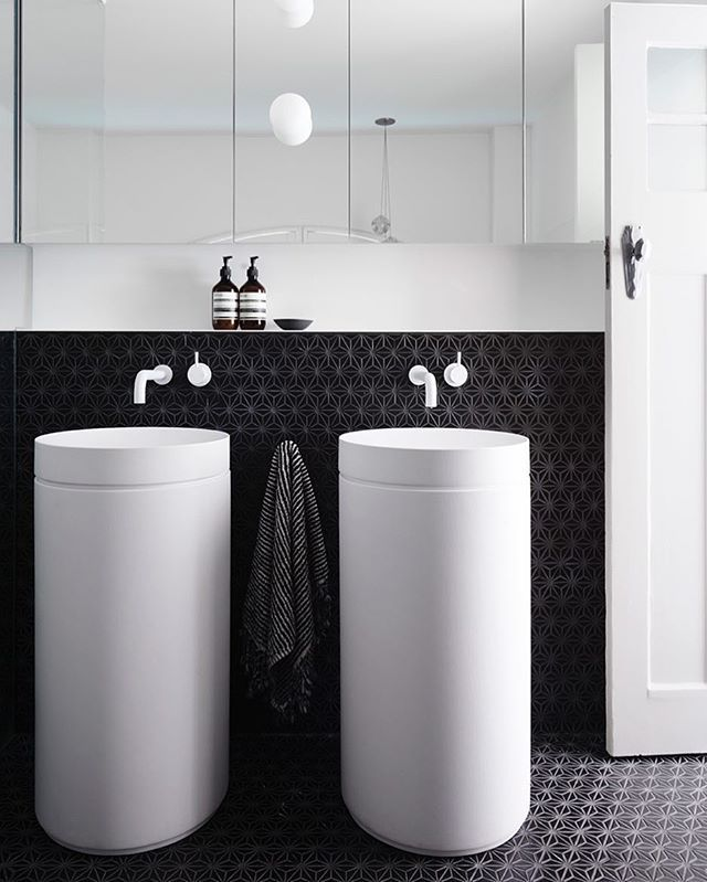 White tapware is possibly the new trend and those architectural basins!, showcased beautifully within an elegant monochromatic 'his and hers' Ensuite - that's right, no sharing here!  This Monochromatic heaven by Melbourne architectural firm @the_northbourne_effect. Flawlessly Captured  by the brilliant @evegwilson.