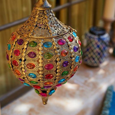 """Our jewel-encrusted, cast iron lantern evokes a Moroccan bazaar—with a hint of a handcrafted stained glass window thrown in for good measure. - Multicolor - 9""""Dia x 27.80""""H (XL Version) - Cast iron, a"""