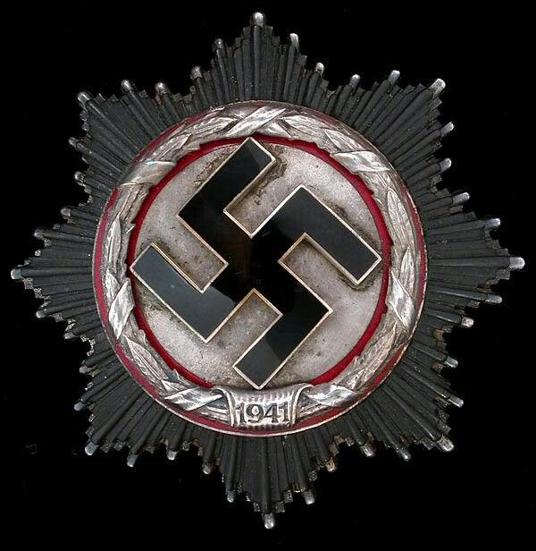 The German Cross in Silver. This military award of Nazi Germany was the intermediate between the War Merit Cross 1st Class and the Knights Cross of the War Merit Cross. Despite name and design it was not in line with the far more common German Cross in Gold, which belonged to the Iron Cross. [Deutsches Kreuz in Silber]