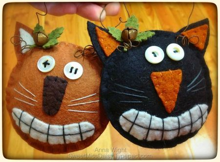 Great vintage style wool felt Halloween cat ornaments, using hand drawn patters, wool felt, embroidery floss, rusty wire, bells, & mother of pearl buttons.