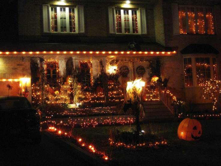 halloween outdoor decoration idea ive been thinking about adding orange and purple lights to my house during halloween i always feel like it lacks a lot