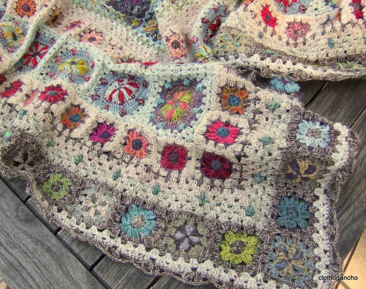 Afghan in different grannies. See how the use of the selected yarns can hi-lite the look of your work! No pattern for this one