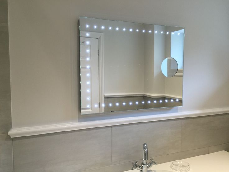 Gallery For Website LED illuminated bathroom mirror with integrated x magnifying mirror