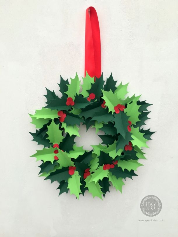 learn how to make a holly wreath from paper christmas paper crafts pinterest christmas christmas wreaths and wreaths