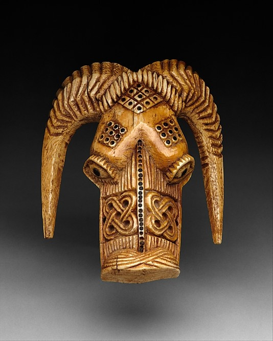 Masquerade Element: Ram Head (Omama) | 17th–19th century | Nigeria Culture: Yoruba peoples, Owo group | Medium: Ivory, wood or coconut shell inlay
