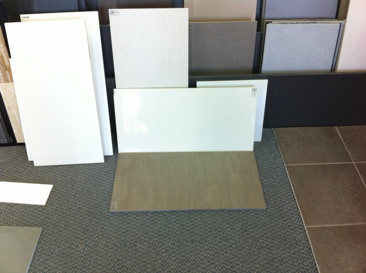 Made our tile selection for bathrooms and off-garage corridor. We are going with 300 x 600 AT-Stone Mocha for floors and possibly a feature wall and 300 x 600 Lumina White Polished tiles for walls.