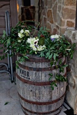 Absolutely Love this rustic barrel planter!