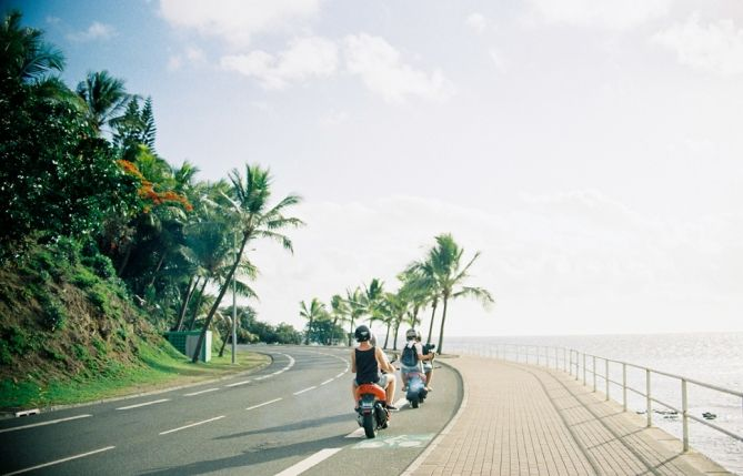 Cruise. Film. Sunset. Scooters. Mopeds. Noumea.