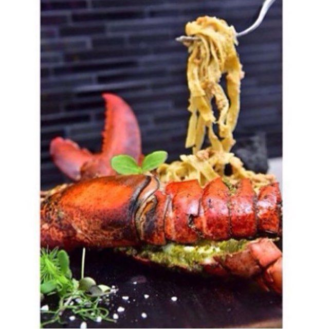 """""""Rockefeller"""" 650g Canadian lobster or 500g Thai river prawn with Cilantro-garlic butter broiled Rockefeller, with fresh fettuccini, river prawn tomalley thermidor sauce Created by Iron Chef Art #ironcheftable"""
