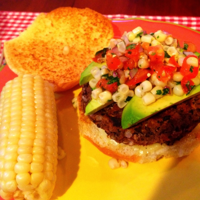 Black bean burger with avocado, pepper jack cheese, and corn & tomato ...