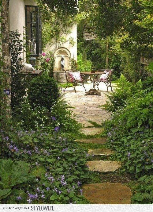 Could I please have this?  outdoor setting alfresco stone lime Italian wrought iron foliage