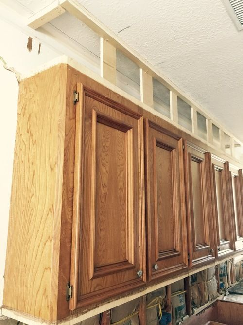 Rip out the soffet and build faux cabinets above.