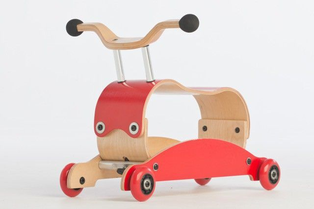 Wishbone Mini Flip - The innovative flipping mechanism means that you can transform the mini flip from a rocker to a baby walker and to a ride-on toy in seconds. One great piece with 3 brilliant uses. The Wishbone Mini Flip is easy to assemble and can be done in just miniutes. Racing red scooter wheels are used for stability. This is a great piece for baby's first steps.