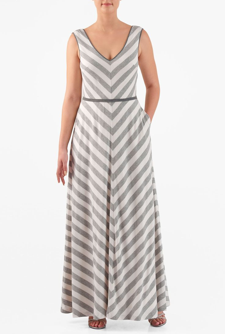 Chevron stripes pattern our retro cotton knit dress styled with a fitted bodice and flared skirt, and cinched in with a self-piped waist for a flattering touch.