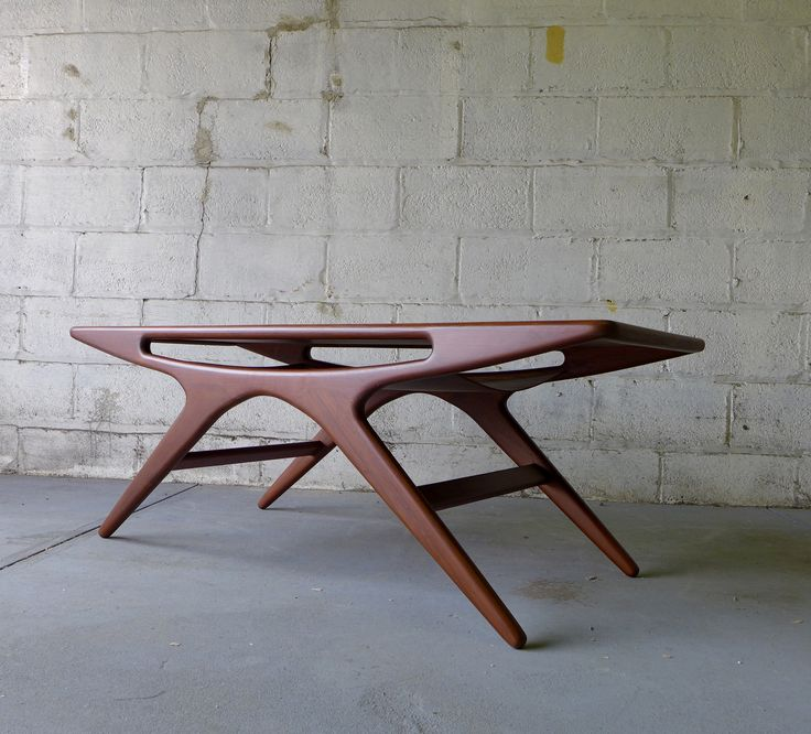 MID CENTURY COFFEE TABLE | Teak Mid Century Modern styled Coffee Table  | Discover more coffee tables ideas: www.bocadolobo.com #moderncoffeetables #luxurycoffeetables