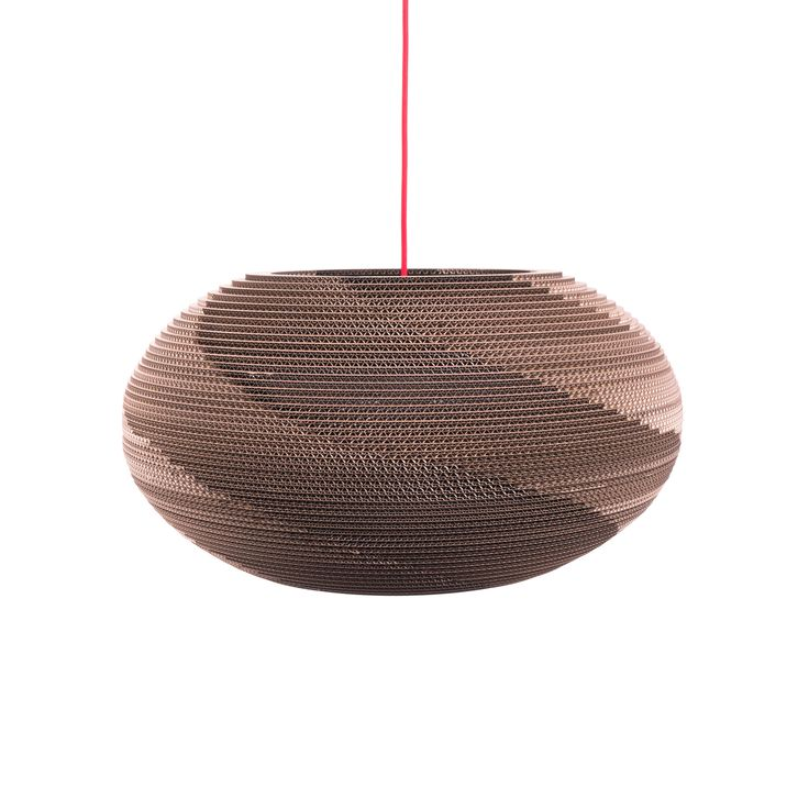 shade in the shape of a flattened spheroid induces pleasant atmosphere in a living-room or above a dining table. The structure of the cardboard creates an impressive spiral of light around the shade. Choose a pendant cable with the shade to fit your room.