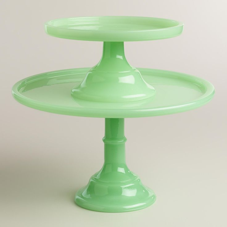 In an ethereal opaque green hue, this glass pedestal boasts a classic cake stand silhouette that's perfect for showcasing your latest kitchen creation. www.worldmarket.com #WorldMarket Farmhouse Home Decor