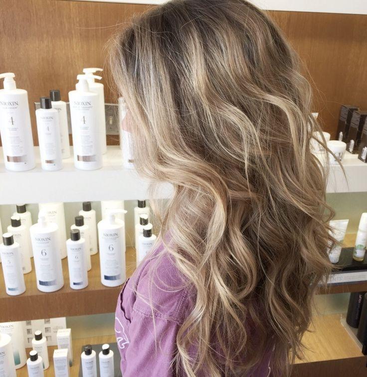 Sandy blonde balayage. Waves. Shoulder length. Blonde. Layers.