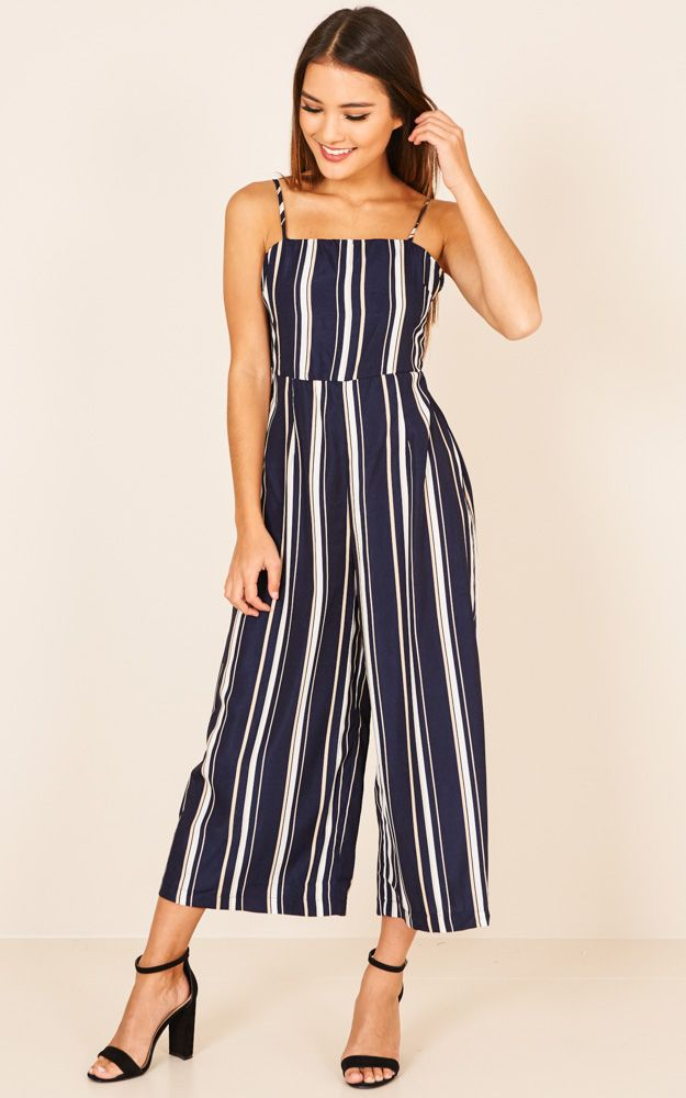 034c7ba865 Jumpsuits are such a trending look right now and we are loving it! This  gorgeous wide leg style features a bold stripped print and an open back.