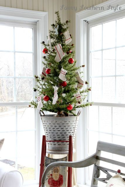 Sweet little Christmas tree inside an olive bucket, by Savvy Southern Style, featured on I Love That Junk. Check out this tour for more!