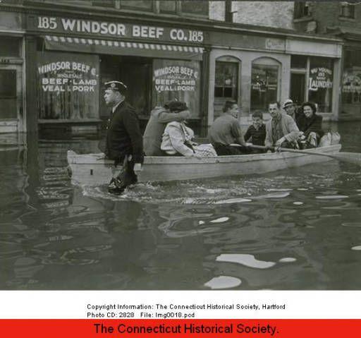 Hurricane of 1938: people in rowboat on Windsor Street, Hartford, September 23, 1938. :: Connecticut History Online