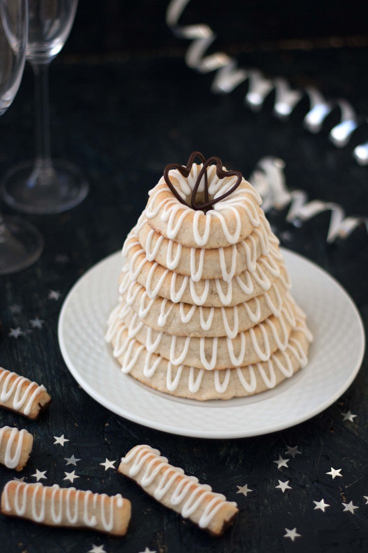 This recipe for a danish marzipan ring cake (Kransekage) with icing is easy to make and very delicious. It only consist of three ingredients!