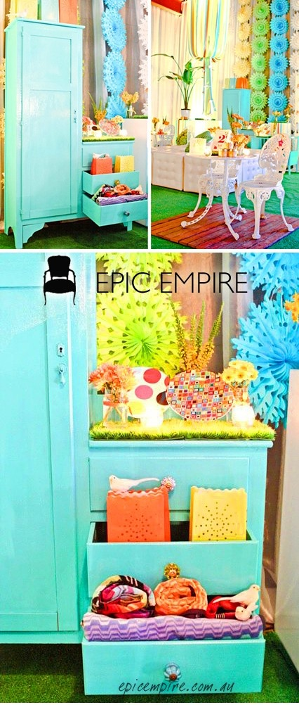 Tiffany Blue Cupboards and Sideboards and White Chesterfield Ottoman with colorful lanterns, pastel paper wall decors,  bright florals and some cute novelty items.   http://www.epicempire.com.au