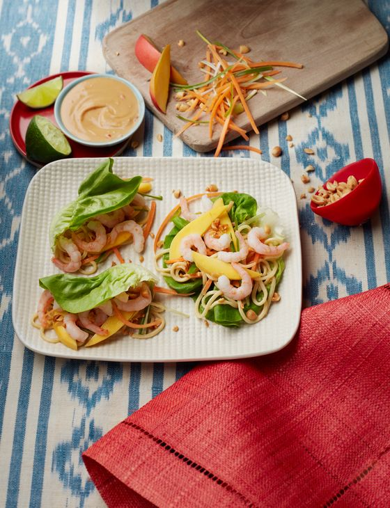 Satay noodle lettuce wraps with prawns and mango - A simple satay-style dressing brings together the exotic flavours in these lettuce wraps.