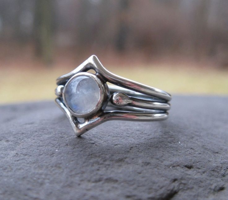 New Moon . sculpted in sterling silver with rainbow moonstone . made to order in whole, half or quarter sizes, $136.00 USD
