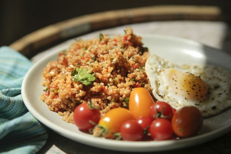A sunnyside-up fried egg added to the Armenian-style Tomato, Pepper and Bulgur Salad (Eech), a recipe from Matthew Card. Stephanie Yao Long/Oregonian Staff