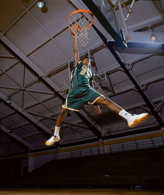 SI Photo Blog - LeBron James, 17, dunks for the camera on Feb. 2, 2002 at St. Vincent–St. Mary High School in Akron, Ohio. The 12-time NBA All-Star, four-time MVP, and three-time Finals MVP — who brought an end to a 52-year major sports championship drought in Cleveland — is SI's 2016 Sportsperson of the Year. (Michael J. LeBrecht II) GALLERY: LeBron James Off the Court #LeBron James#St. Vincent–St. Mary#NBA#basketball#LeBron