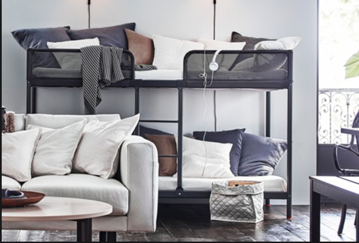 IKEA tuffing bunk blues and whites, marble flooring, grey L couch opens up to be a 3rd bed