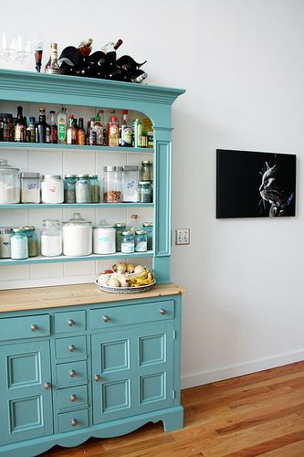 small kitchen? This couple repurposed a hutch to use as their pantry.