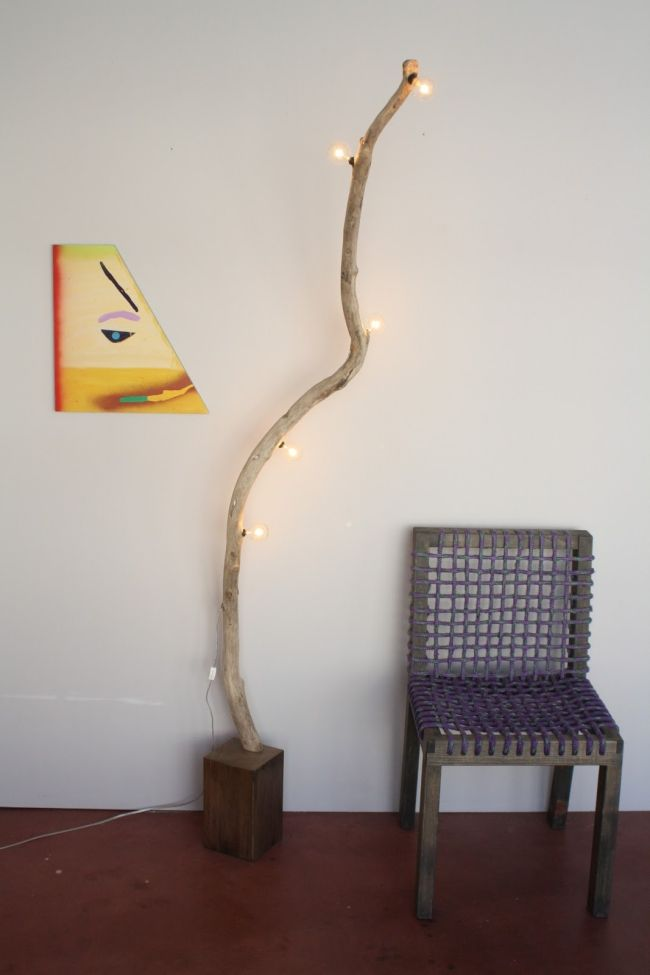 artsy modern wood floor lamp made from a branch and light bulbs