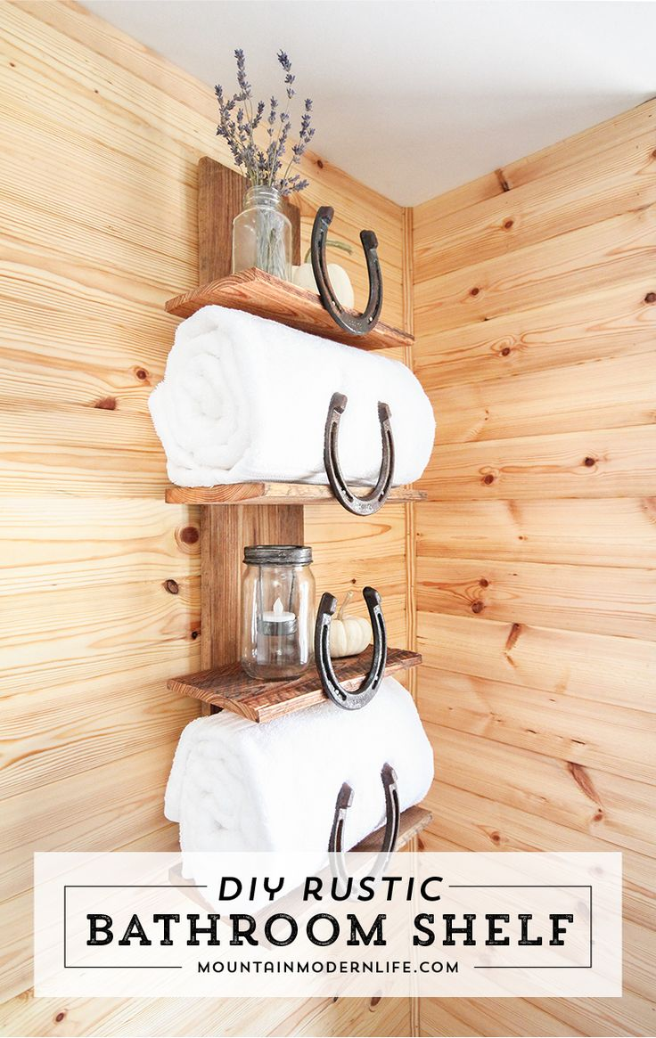 Want to add a rustic, mountain, or Southwestern touch to your home? See how easy it is to create this rustic bathroom shelf with horseshoes. via @MtnModernLife