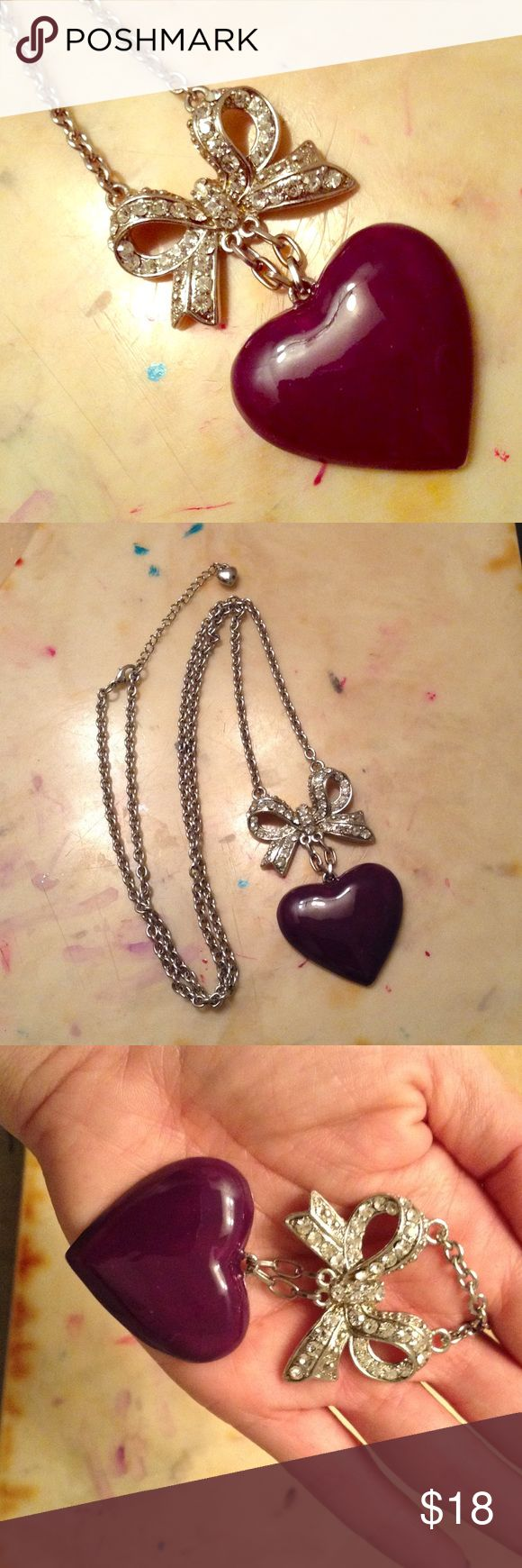 17 in purple heart w/ rhinestone bow necklace Super cute 17in long necklace / purple enamel heart with rhinestone bow / long necklaces elongates your figure can spice up any outfit / cleaning out my jewelry armoire open to offers Jewelry Necklaces