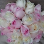Pink and white rose bouquet,i'd just go for a darker pink rose