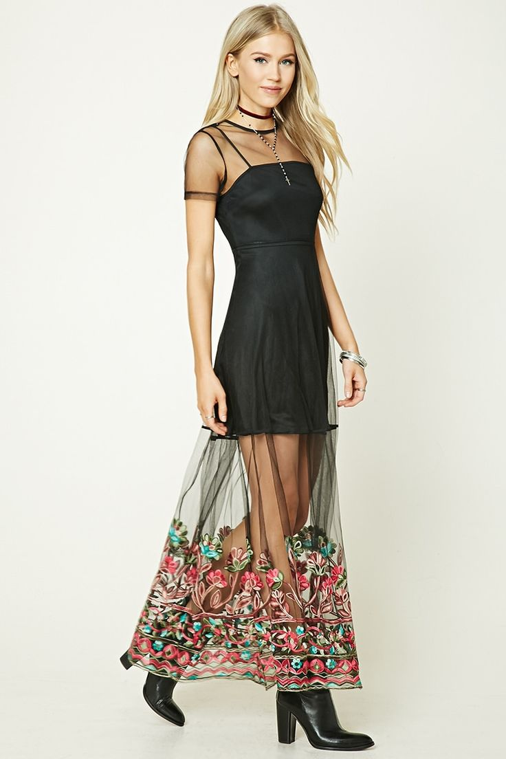 A sheer mesh knit maxi dress featuring an embroidered floral hem, a round neckline, short sleeves, a back zipper, and a detachable mini lining with a V-neckline.