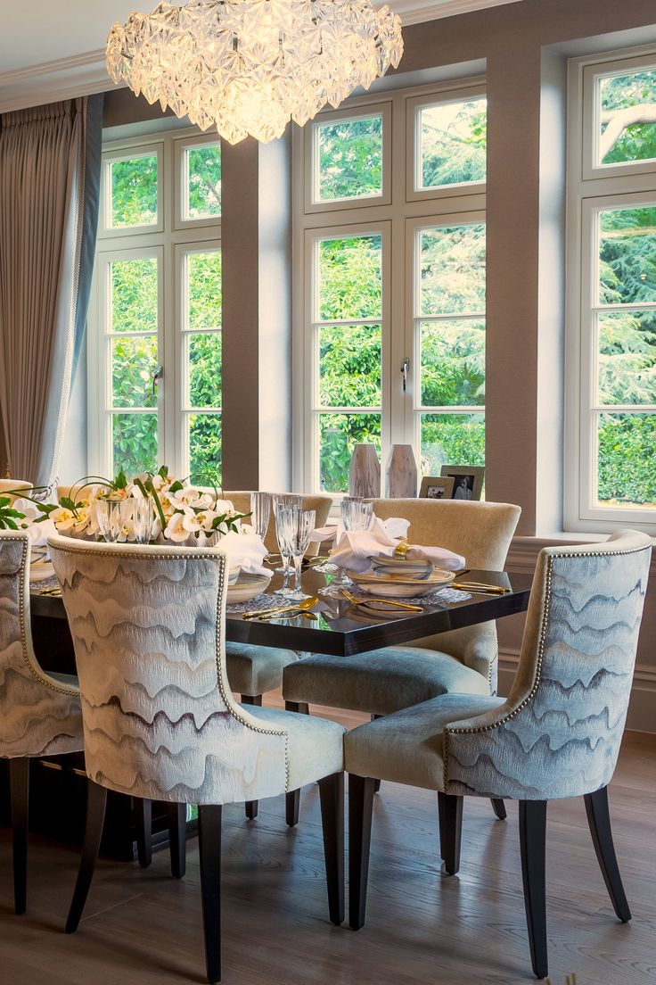 The charismatic Zinc Textile fabric chairs with beautiful gold studded detailing add vigour and personality to this elegant interior design in our Millgate country estate project.