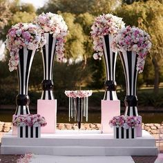 So chic and modern!! Black and white stripes with pink accent wedding venue styling