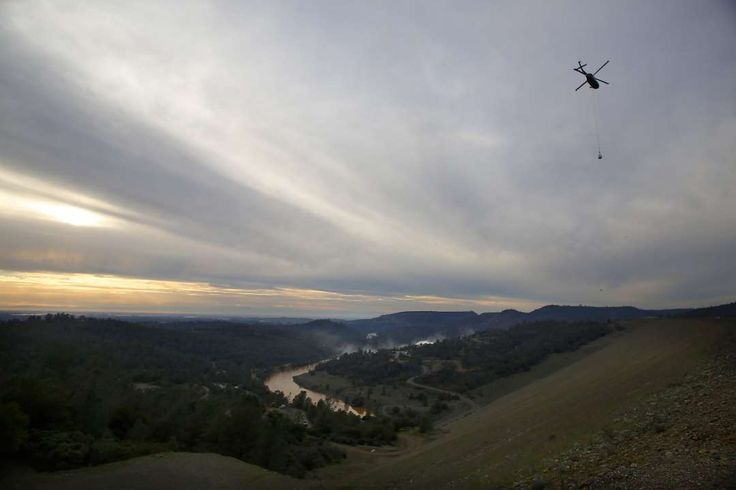 Dramatic new images show scale of damage to Oroville Dam spillway -  February 28, 2017:      Helicopters cary huge bags full of rock to stabilize the emergency spillway next to the Oroville Dam on Monday Feb. 13, 2017, in Oroville,  Ca.