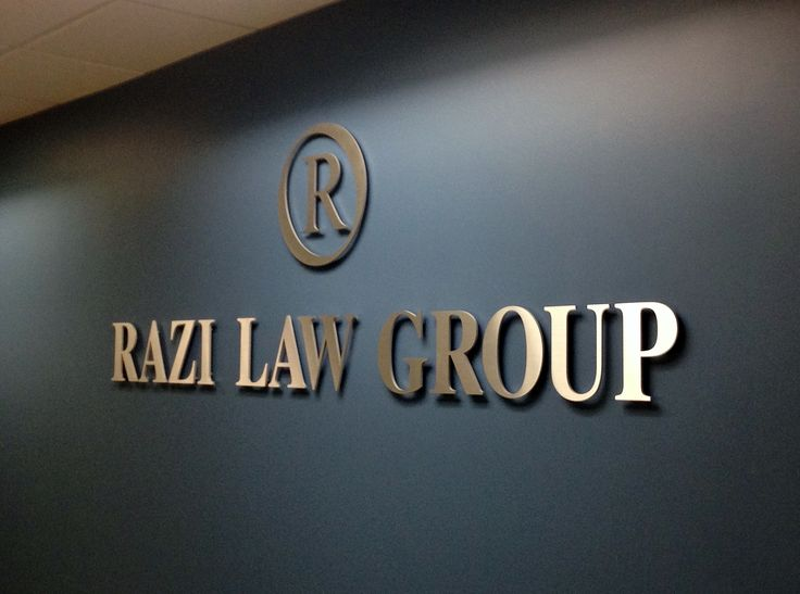 Office Reception Area Sign.  Satin aluminum letters and logo by J & G Diversified, Inc. make a bold and confident statement in this entrance area.   Photo courtesy of Razi Law Group Beverly Hills CA.  http://www.cut-metal-letters.com