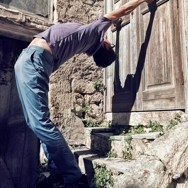 Standing Back Bend with support from old door knockers, Modica, Sicily. #YogaTip: Engage the front of your abdominal muscles (transverse and rectus abdominus) to protect your lower back and help you to bring more back bend to your upper back (lift your sternum!). Learn more at my workshops... #adventurebeginsatOM #adventureyoga #yogatips #yogamaze #yogapracticenotyogaperfect