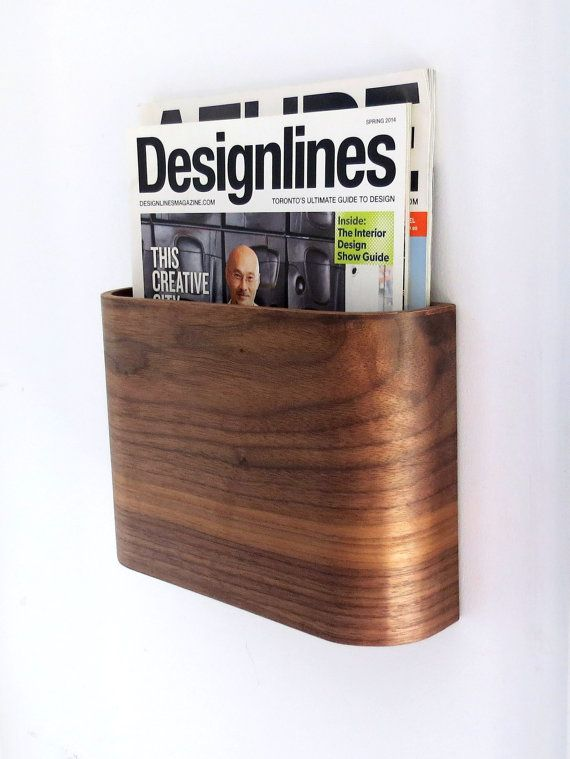 Simple and graceful wooden magazine rack. Easy to install, takes up minimal space, and provides a beautiful wood accent to the room. Holds 5 to 10