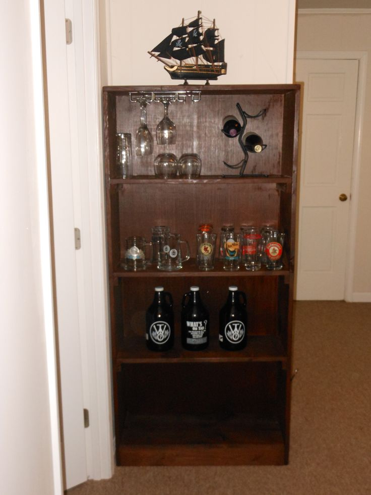 Jonathan turned a bookshelf his dad made him as a child into a bar. Doors may go over the bottom cubby to make a locking liquor cabinet.