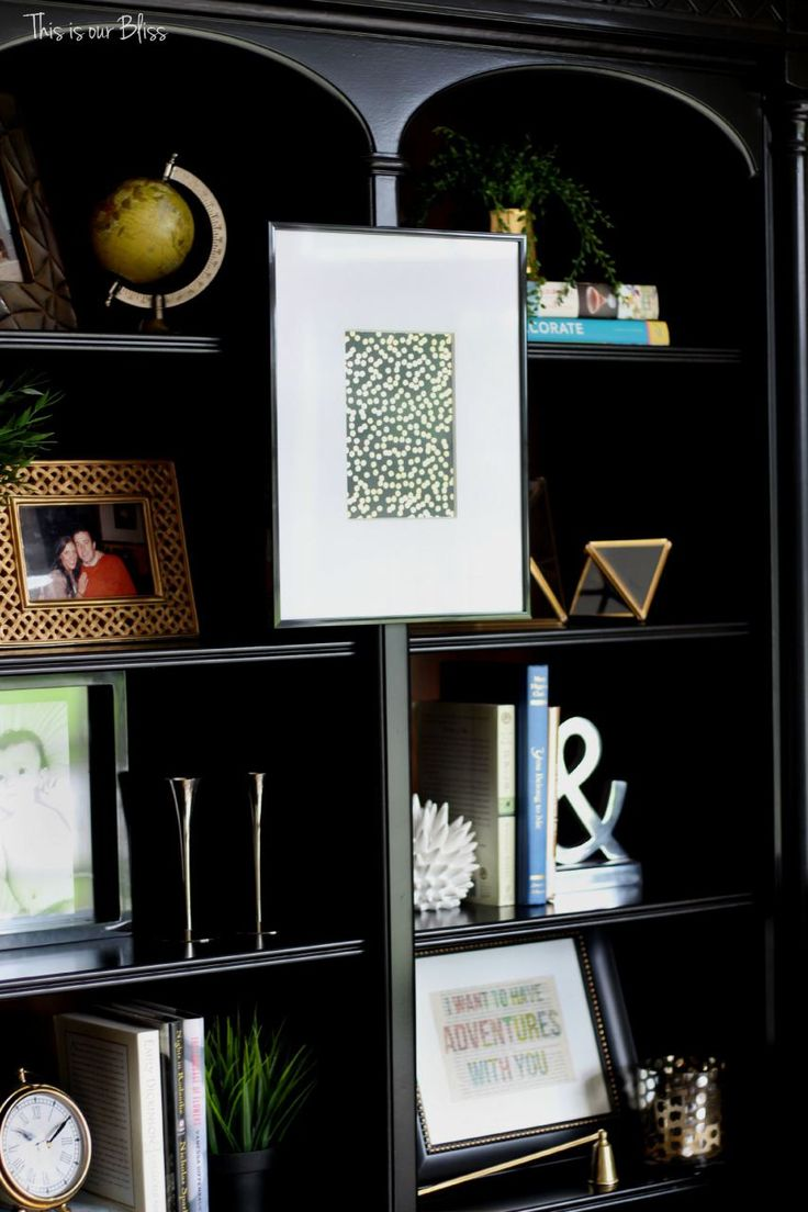 how to update an old bookcase with command hooks - 30 second makeover - formal living room bookcase - hanging art on a bookcase - This is our bliss