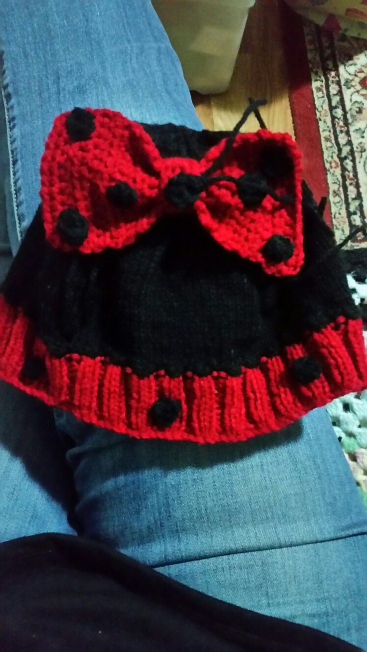 Minnie Mouse hat knitted in 8 ply crochet little circles, crochet bow with Pom Poms