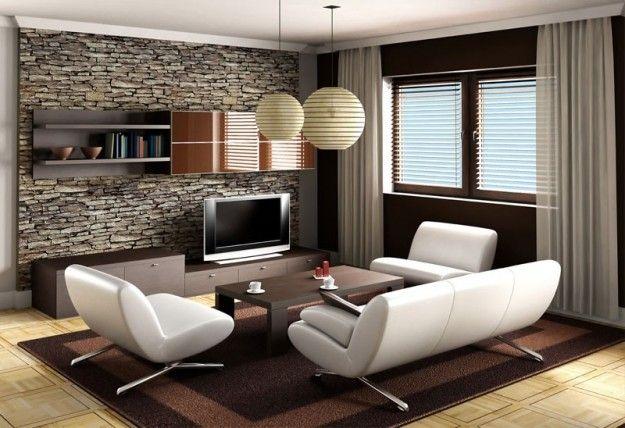 Divani bianchi e pareti in pietra - Abbinare il divano alle pareti per un ambiente moderno dal sapore rustico.