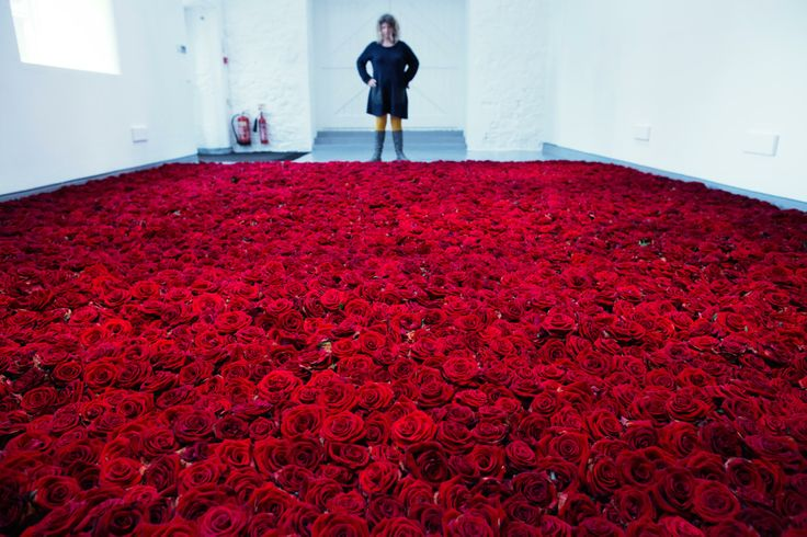 Anya Gallaccio 'Red on Green' will see the decay and destruction of 10,000 red roses laid in a field upon the gallery floor.