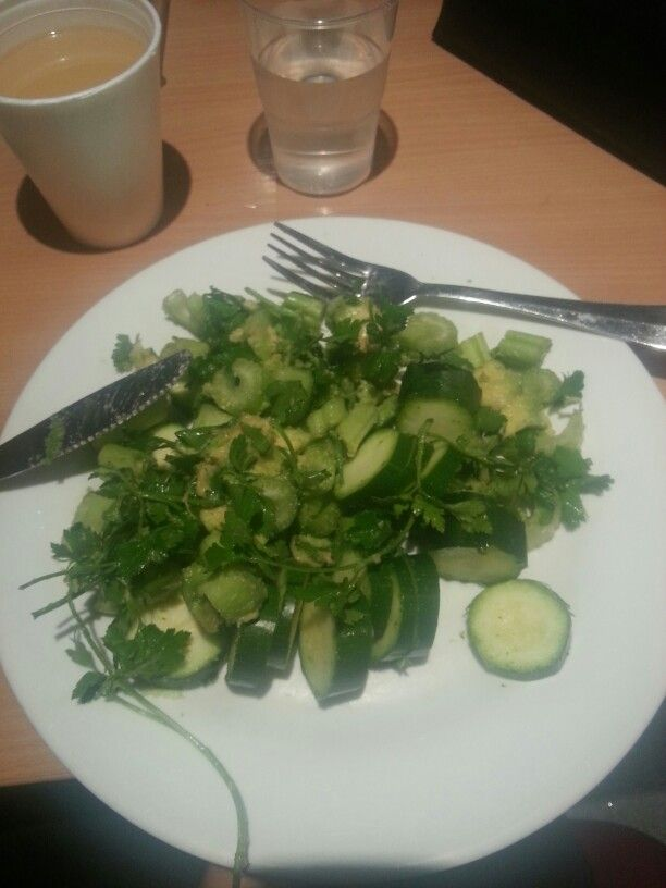 Half avocado with celery, parsley, courgette
